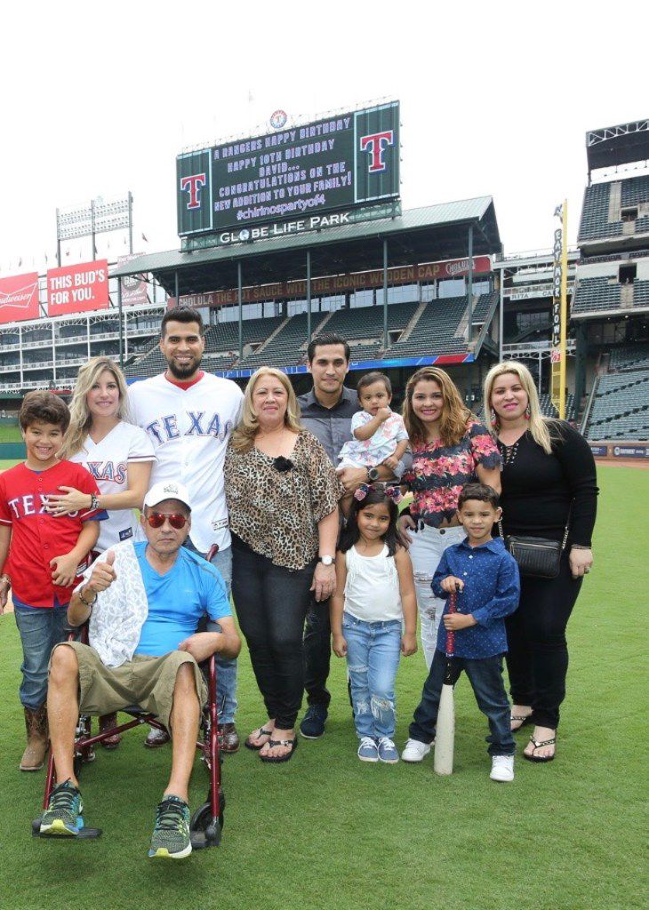 Rangers catcher Robinson Chirinos, (standing, third from the left) has been outspoken about corruption in Venezuela. Here he is pictured at Globe Life Park in Arlington with his family. (Courtesy/Robinson Chirinos)