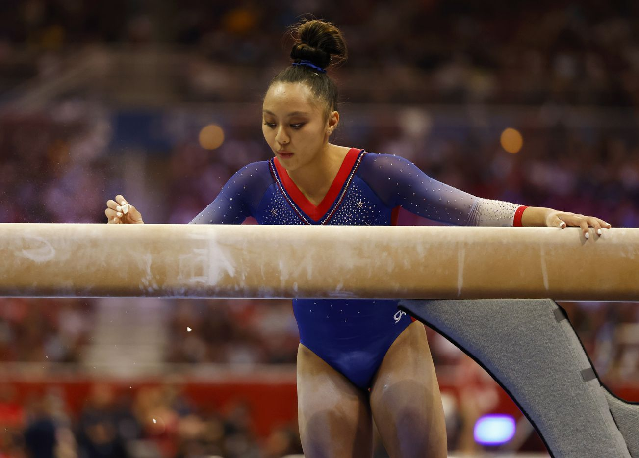 Emma Malabuyo of Texas Dreams marks her spot on the balance beam with chalk before competing during day 1 of the women's 2021 U.S. Olympic Trials at America's Center on Friday, June 25, 2021 in St Louis, Missouri.(Vernon Bryant/The Dallas Morning News)