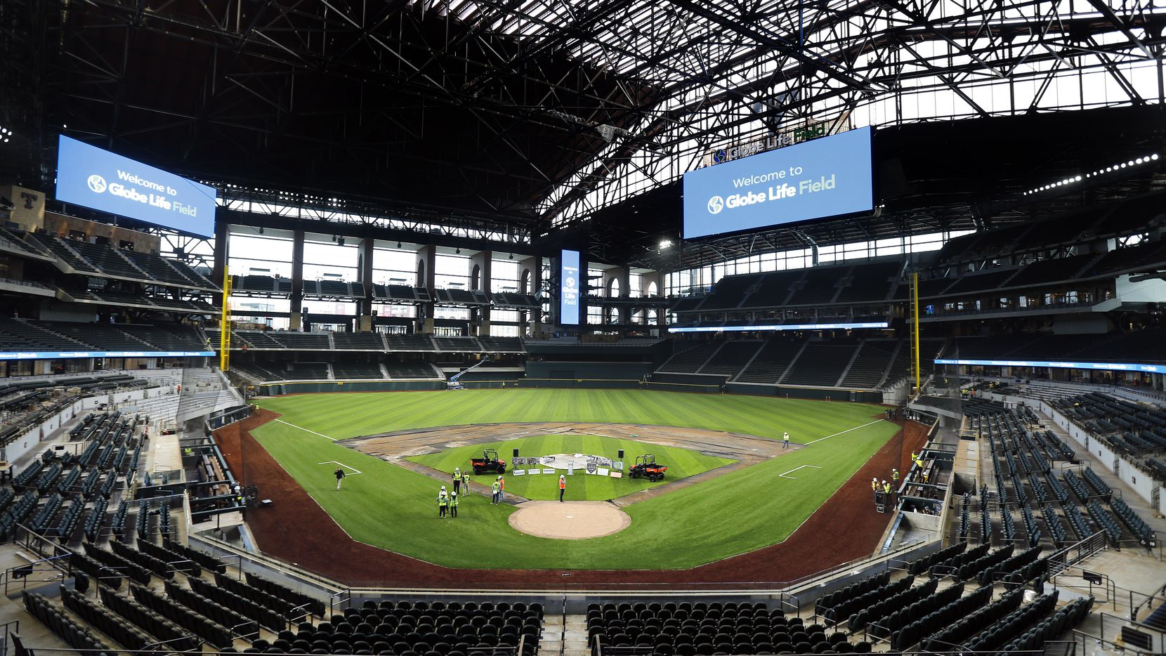 The artificial turf by Shaw Sports Turf is being installed at the new Globe Life Field under construction in Arlington, Texas, Wednesday, March 4, 2020. The ballpark is nearing completion.