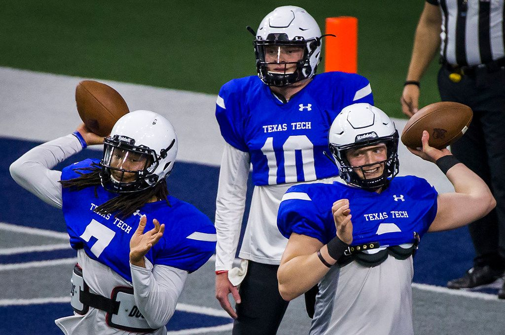Texas Tech quarterbacks Jett Duffey (7), McLane Carter (6) and Alan Bowman (10) warm up before the Red Raiders' spring scrimmage at the Star on Saturday, April 7, 2018, in Frisco. (Smiley N. Pool/The Dallas Morning News)