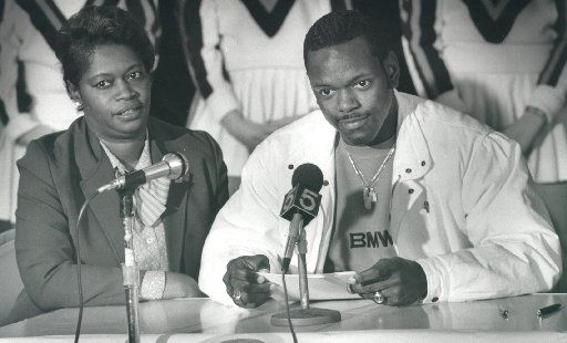 ORG XMIT: S0401485357_STAFF Undated.. Emmitt Smith announces his college plans during a news conference after his senior year of high school. His mother, Mary, is at left.