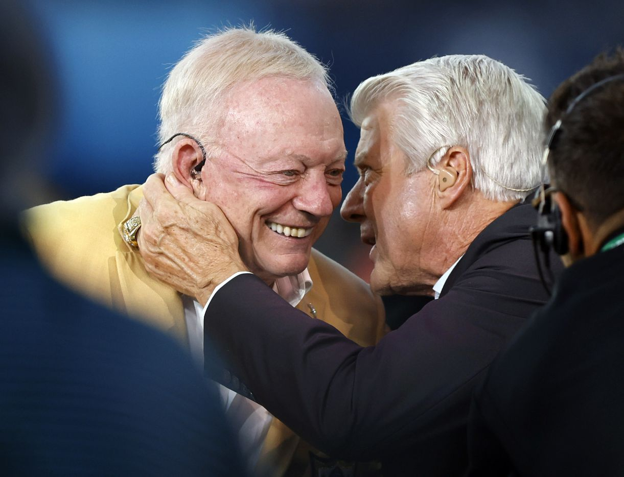 Dallas Cowboys owner Jerry Jones (left) and his former head coach Jimmy Johnson embrace on the FOX Sports broadcast before the Dallas Cowboys Pittsburgh Steelers preseason game at Tom Benson Hall of Fame Stadium in Canton, Ohio, Thursday, August 5, 2021. Johnson will be inducted into the Hall of Fame Saturday. (Tom Fox/The Dallas Morning News)