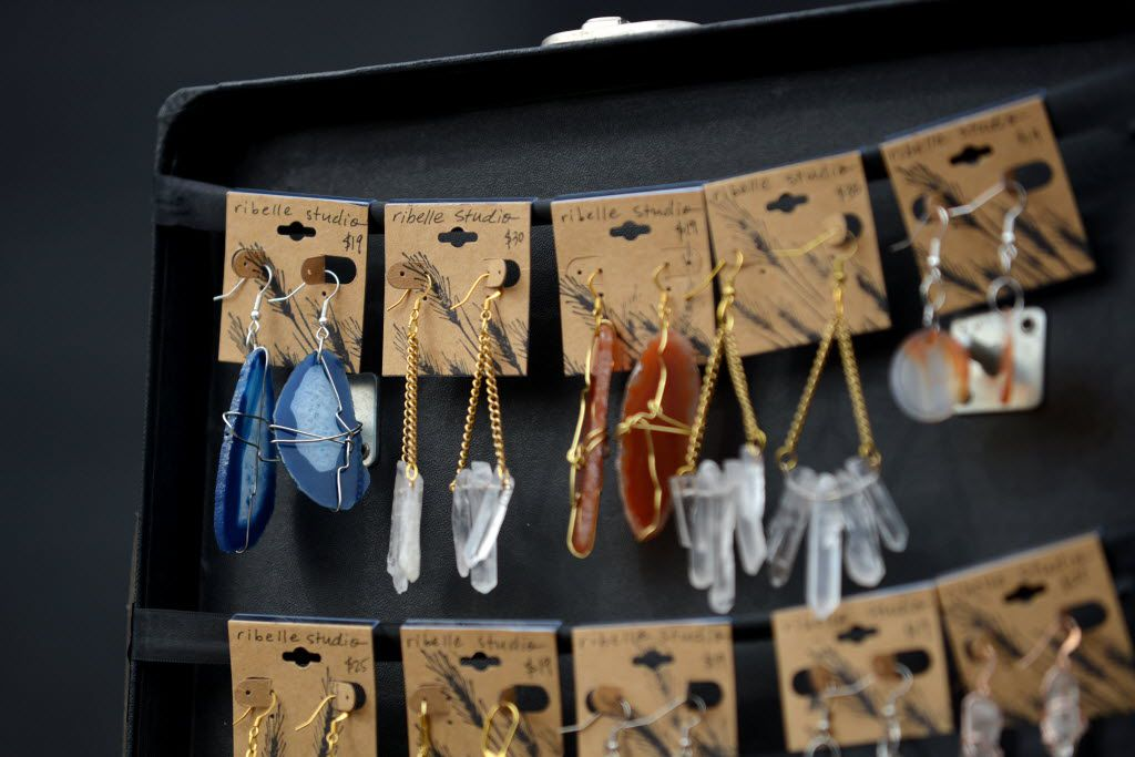 Handcrafted earrings are on display during a Garland market.