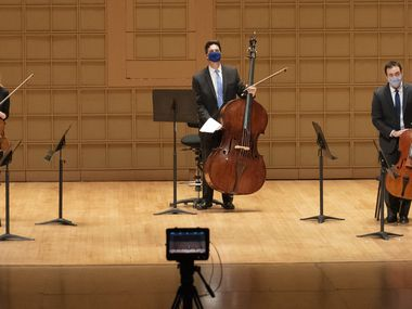 Members of the Dallas Symphony Orchestra were introduced for a video recording before performing George Walker's Lyric for Strings at the Morton H. Meyerson Symphony Center in Dallas on June 13. The recording was done to bring the sounds of the DSO to people's homes during the coronavirus pandemic.