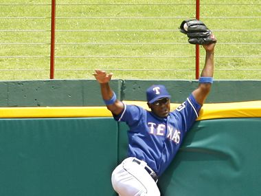 FILE - Rangers center fielder Gary Matthews Jr. robs the Astros' Mike Lamb of a home run in the eighth inning of a game on Saturday, July 1, 2006, in Arlington. (AP Photo/Matt Slocum)