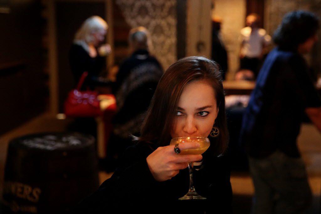 Dasha Kiseleva tries a mixed drink inside High & Tight.