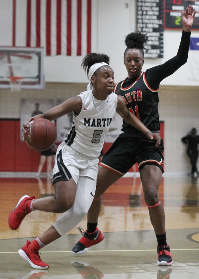Arlington Martin's Mariah Roberts (5) drives to the basket against the defense of South Grand Prairie's Jahcelyn Hartfield (11) during first half action. The two teams played their District 8-6A  girls varsity basketball game at Arlington Martin High School in Arlington on January 26, 2021. (Steve Hamm/ Special Contributor)