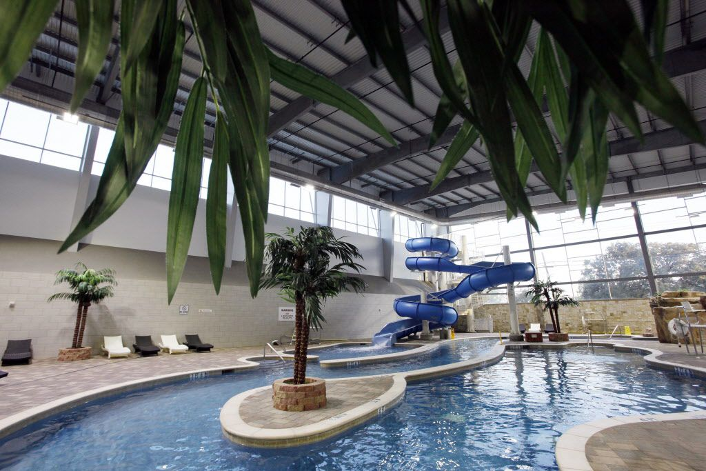 The family pool includes a water slide and splash areas.