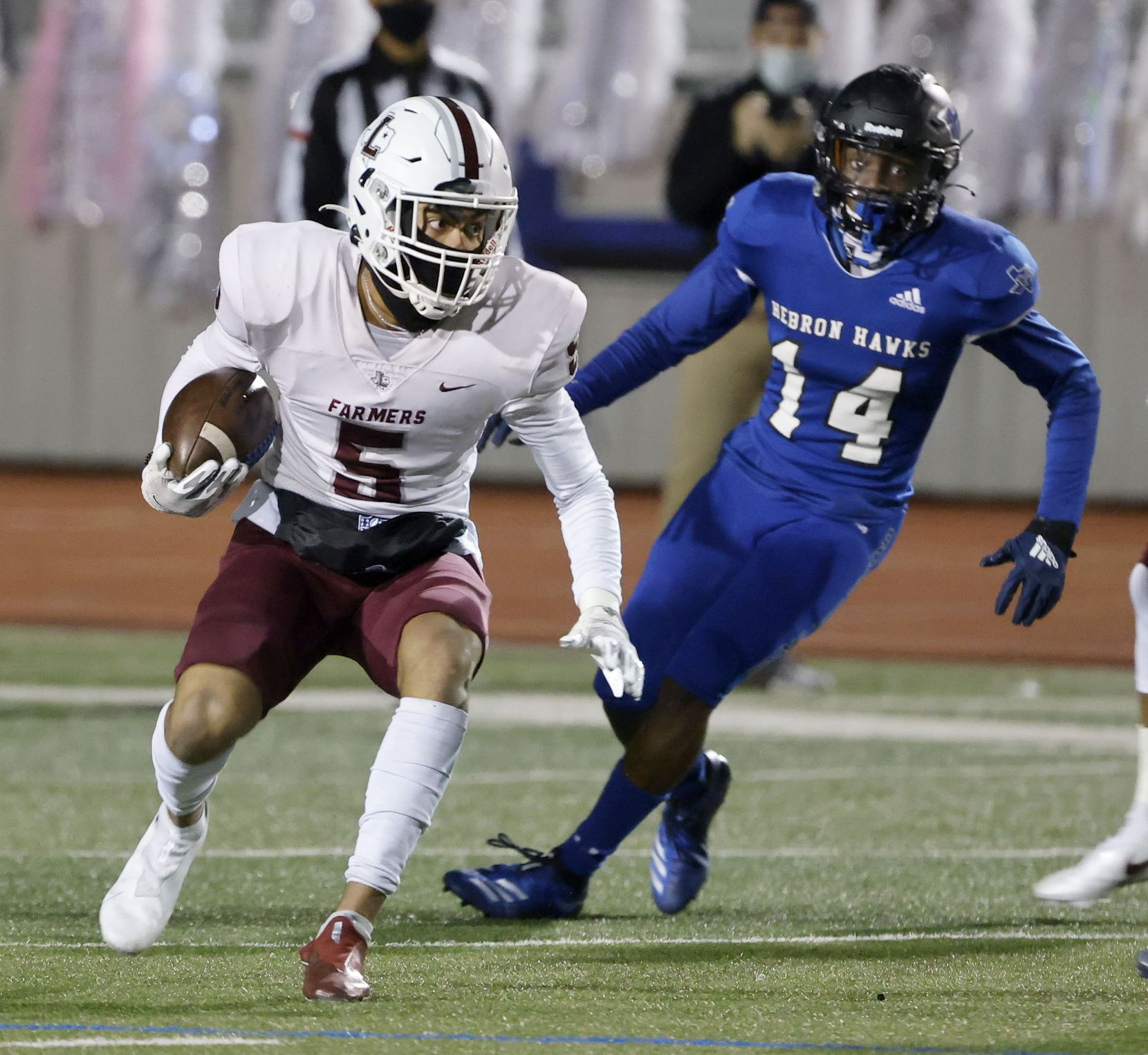 Lewisville receiver Isiah Stevens (5) looks for running room in front of Hebron defender Jonathan Jackson (14) during their District 6-6A high school football game on Dec. 4, 2020. (Michael Ainsworth/Special Contributor)