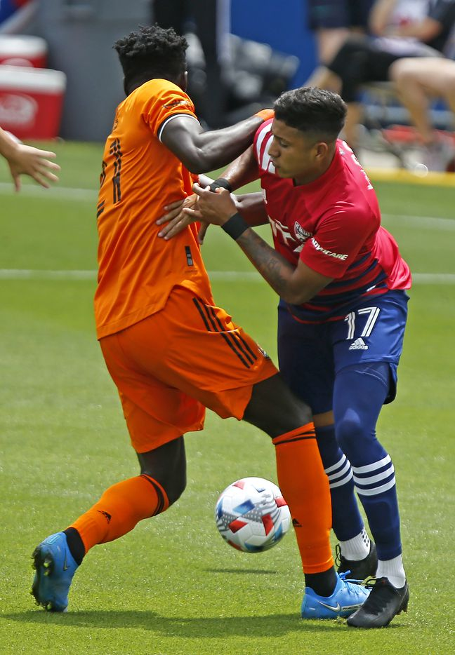 FC Dallas midfielder Freddy Vargas (17) collides with Houston Dynamo midfielder Derrick Jones (21) during the first half as FC Dallas hosted the Houston Dynamo at Toyota Stadium in Frisco on May 8, 2021. (Stewart F. House/Special Contributor)
