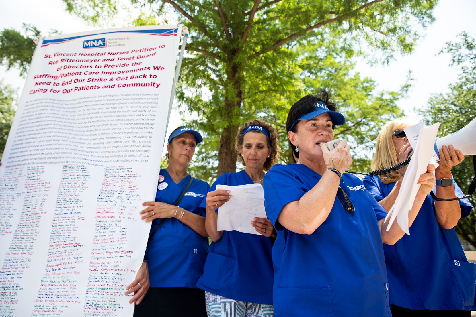 Marie Ritacco, Massachusetts Nurses Association vice president and a nurse of 38 years, speaks at a demonstration outside of the Tenet Healthcare headquarters.