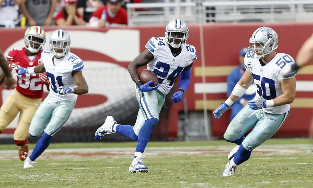 Dallas Cowboys cornerback Morris Claiborne (24) runs the ball after an interception on a pass from San Francisco 49ers quarterback Blaine Gabbert (2) during the second half of play at Levi's Stadium in Santa Clara, California on Sunday, October 2, 2016. The Dallas Cowboys defeated the San Francisco 49ers 24-17. (Vernon Bryant/The Dallas Morning News)