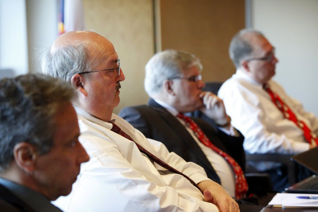 Richard Tettamant, adminstrator of the Dallas Police and Fire Pension System (second from left) Don Rohan (second from right), and Brian Blake (right), at a board meeting in Dallas on Thursday, December 13, 2012.  (Lara Solt/The Dallas Morning News)