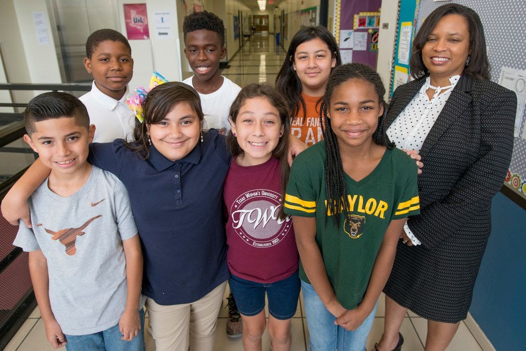 Sonja Barnes, principal of Brashear Elementary, with some of her students in Dallas on September 14, 2018. Barnes is one the DISD principals operating with more autonomy.