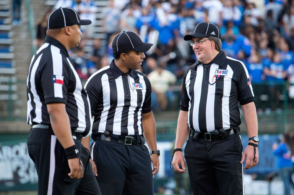 Referees confer before a high school football game between Grand Prairie and South Grand Prairie at the Gopher-Warrior Bowl in Grand Prairie, Texas on Friday, September 30, 2016. (Jeffrey McWhorter/Special Contributor)