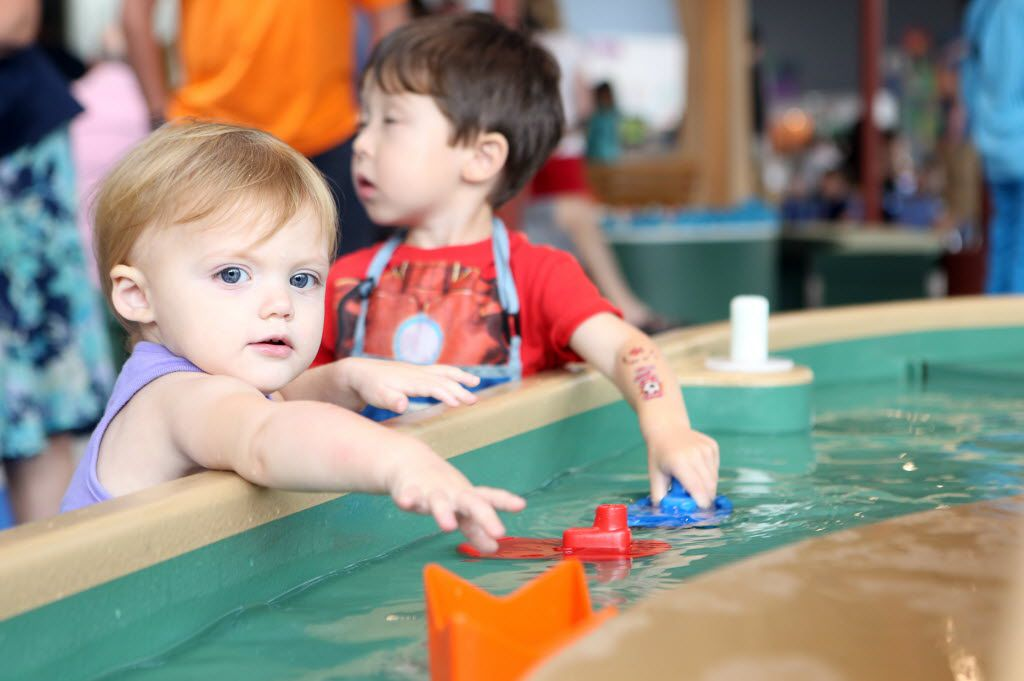 Water tables are part of the fun at Moody Family Children's Museum inside the Perot Museum of Nature and Science.