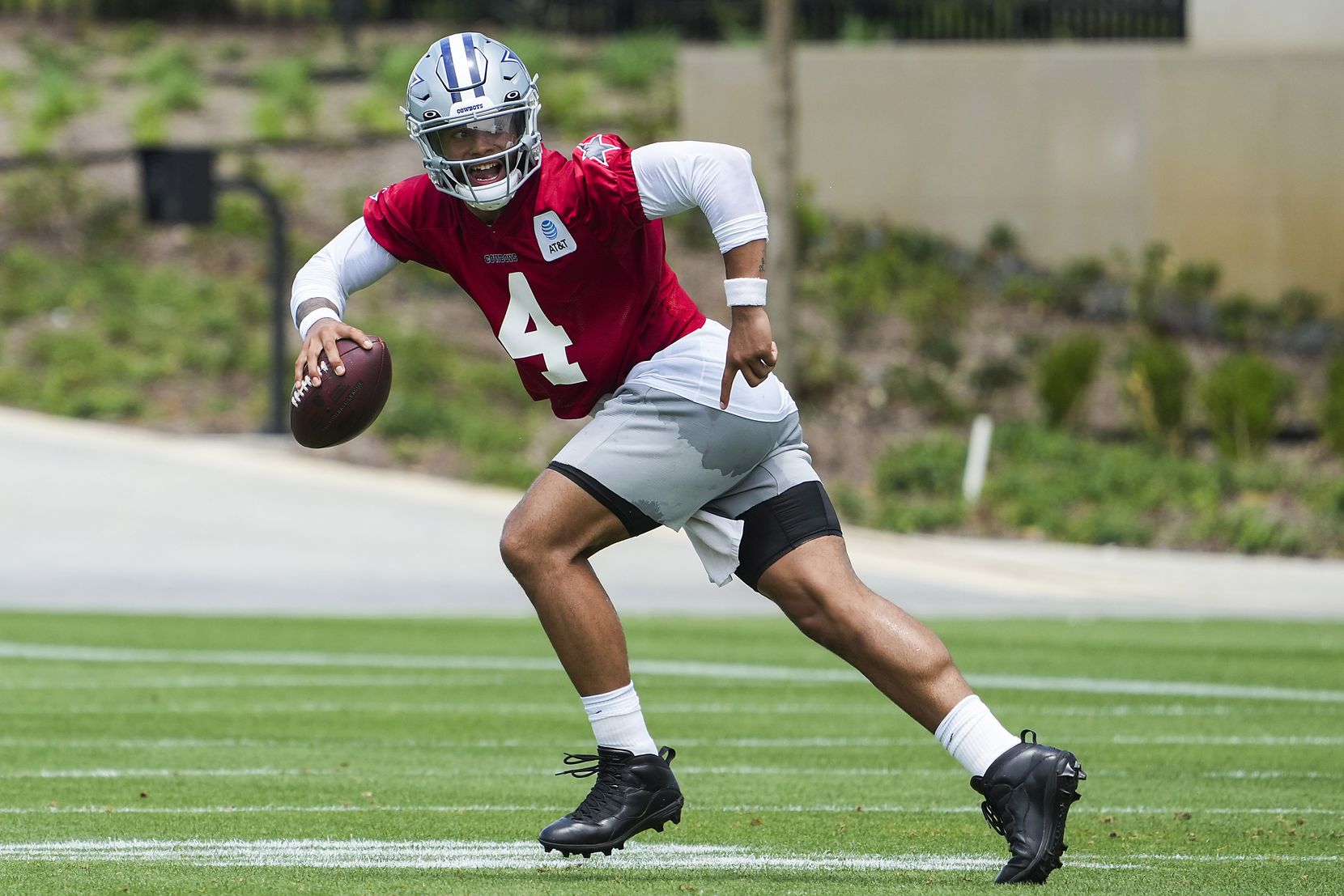 Dallas Cowboys quarterback Dak Prescott (4) runs a drill during a minicamp practice at The Star on Tuesday, June 8, 2021, in Frisco. (Smiley N. Pool/The Dallas Morning News)