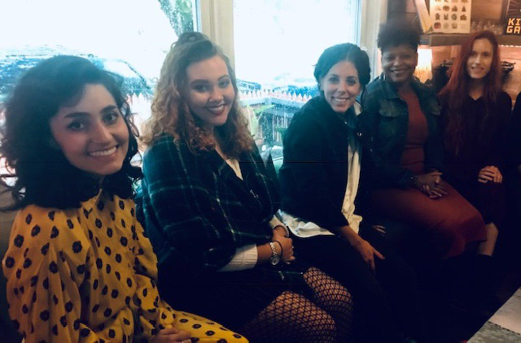 Some of the artists participating in Burning Woman making plans for the Nov. 3 event at the Wild Detectives are (from left) Sammy Rat Rios, Claire Richey, Lauren Smart, Sanderia Faye and Jessica Thomas.
