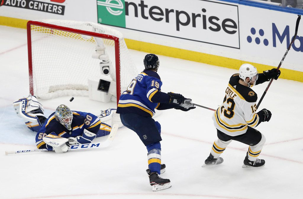ST LOUIS, MISSOURI - JUNE 01:  Charlie Coyle #13 of the Boston Bruins scores a first period goal past Jordan Binnington #50 of the St. Louis Blues  in Game Three of the 2019 NHL Stanley Cup Final at Enterprise Center on June 01, 2019 in St Louis, Missouri. (Photo by Jamie Squire/Getty Images)