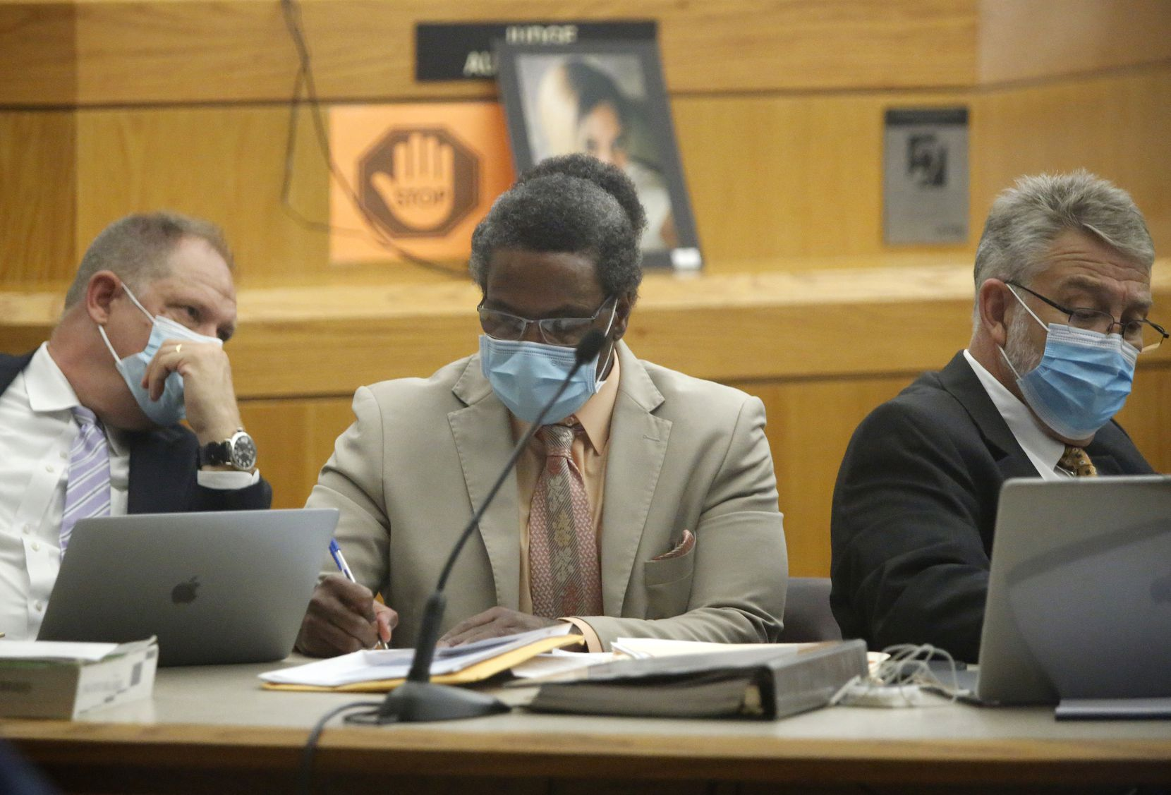 Victor Williams (center) listens as he sits with his defense team during his trial at the Frank Crowley Courthouse in Dallas.