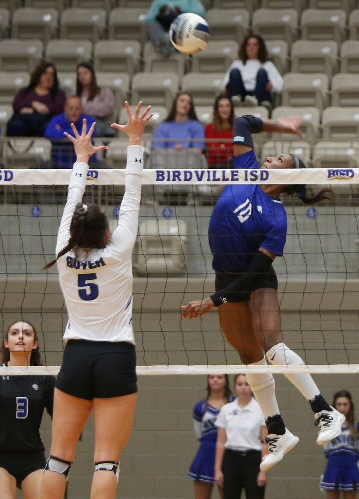 Trophy Club Byron Nelson outside hitter Charitie Luper (10) skies to launch a shot against Denton Guyer defender Hailey Schneider (5) during the first game of their match. Byron Nelson prevailed , 25-18, 25-17, 25-16 to advance to the state tournament. The two teams played their Class 6A Region l championship volleyball match at W.G. Thomas Coliseum in Haltom City on November 16, 2019. (Steve Hamm/ Special Contributor)