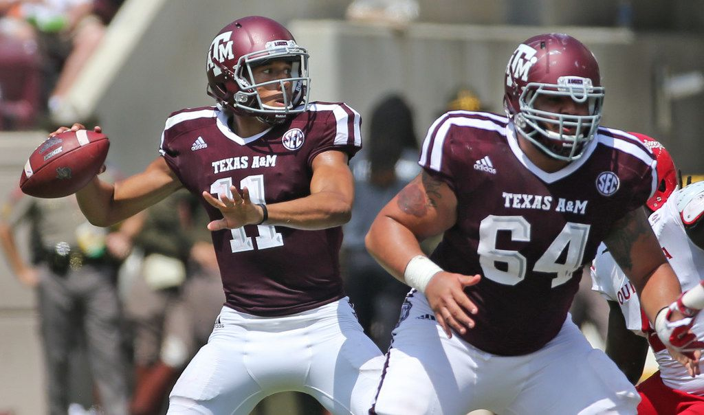 Texas A&M Aggies quarterback Kellen Mond (11) and  offensive lineman Erik McCoy (64) are pictured during the Louisiana Lafayette Ragin' Cajuns vs. the Texas A&M Aggies at Kyle Field in College Stadium, Texas on Saturday, September 16, 2017. (Louis DeLuca/The Dallas Morning News)