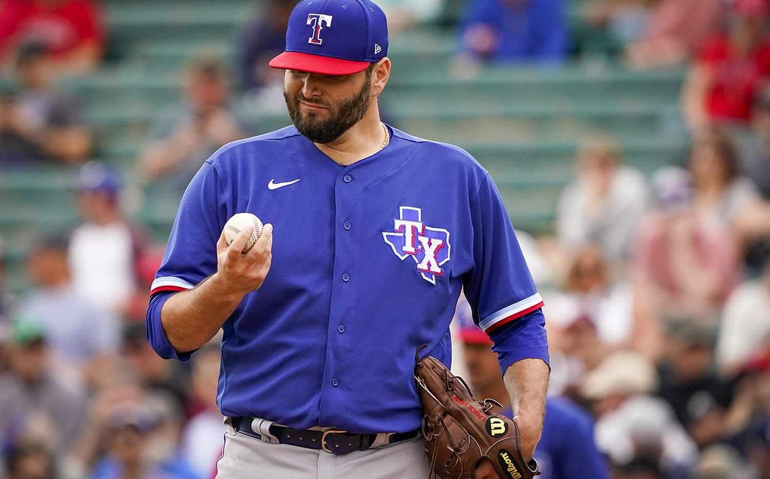 Texas Rangers pitcher Lance Lynn gets a new ball after giving up a run on a single by Los Angeles Angels designated hitter Shohei Ohtani during the first inning of a spring training game at Tempe Diablo Stadium on Friday, Feb. 28, 2020, in Tempe, Ariz. (Smiley N. Pool/The Dallas Morning News)