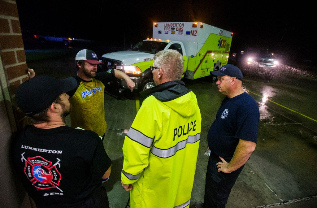 Fire Chief Jeff McNeal, second from right, talks to volunteer Tim Rozell, second from left, at Lumberton Central Fire Station as Hurricane Harvey hit landfall for a second time on Tuesday, August 29, 2017 at Central Fire Station in Lumberton, Texas. Rozell brought a truck to help with rescue efforts. (Ashley Landis/The Dallas Morning News)