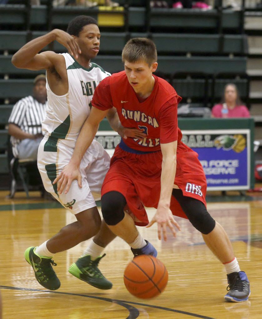 Duncanville's Matt McQuaid (3) moves with the ball in the Duncanville at DeSoto boys basketball game, at DeSoto High School,  on January 10, 2014. (Michael Ainsworth/The Dallas Morning News) 04012015xSPORTS