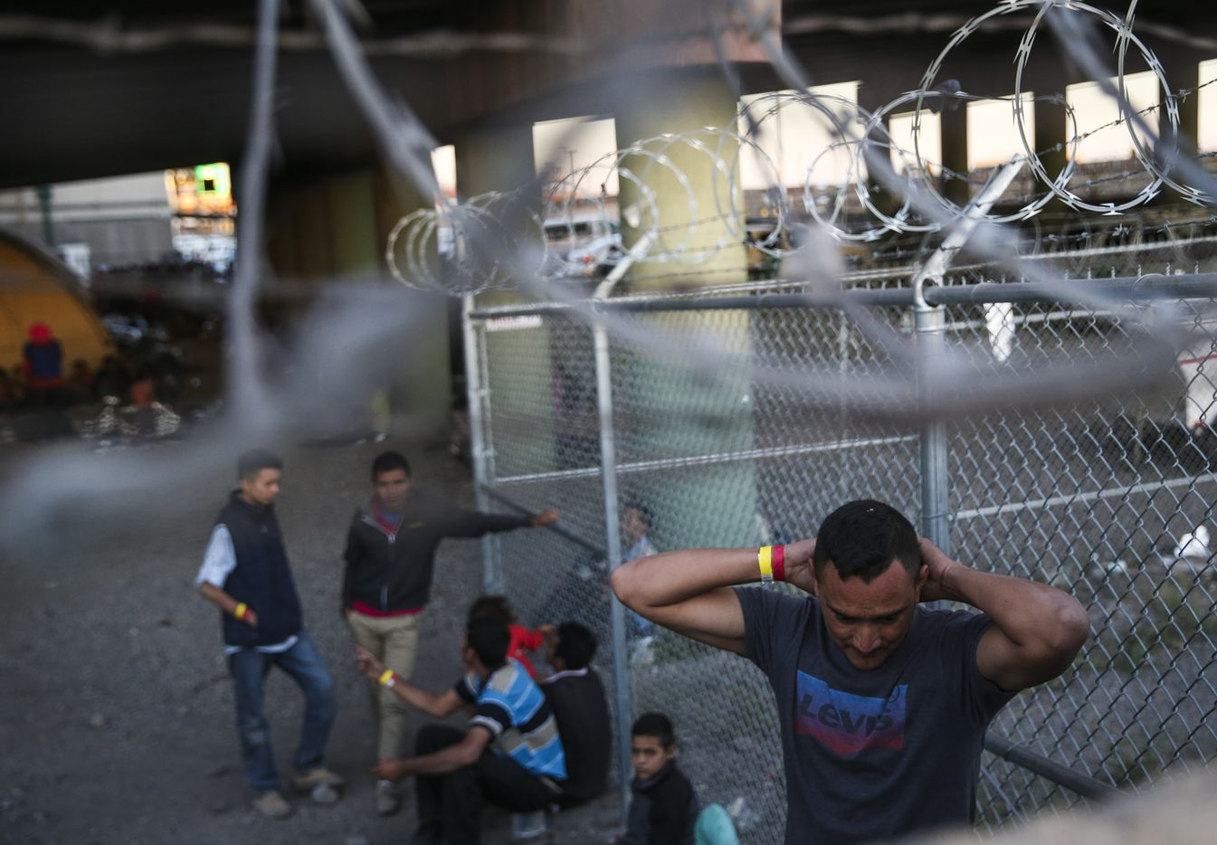 Migrants, including young children and babies, at the U.S. Border Patrol temporary holding area under the Paso Del Norte bridge in El Paso, Texas, on Friday, March 29, 2019.