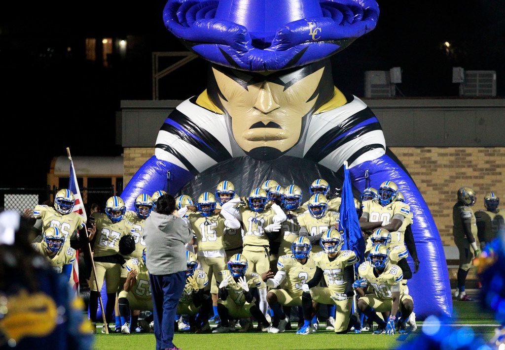 The Lakeview team poses in front of their Patriot run-through tunnel before the start of  their high school football game against Naaman Forest at Homer B. Johnson Stadium on Friday, November 8, 2019. (John F. Rhodes / Special Contributor)
