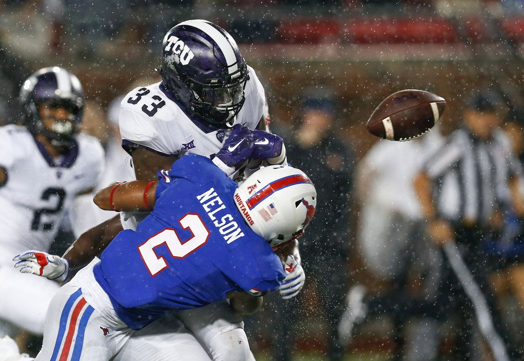 TCU running back Sewo Olonilua (33) fumbles the ball after a hit by SMU safety Patrick Nelson (2) during the second quarter of an NCAA college football game Friday, Sept. 7, 2018, in Dallas. The ball was recovered in the end zone for a touchdown by TCU's Jaelan Austin. (AP Photo/Jim Cowsert)