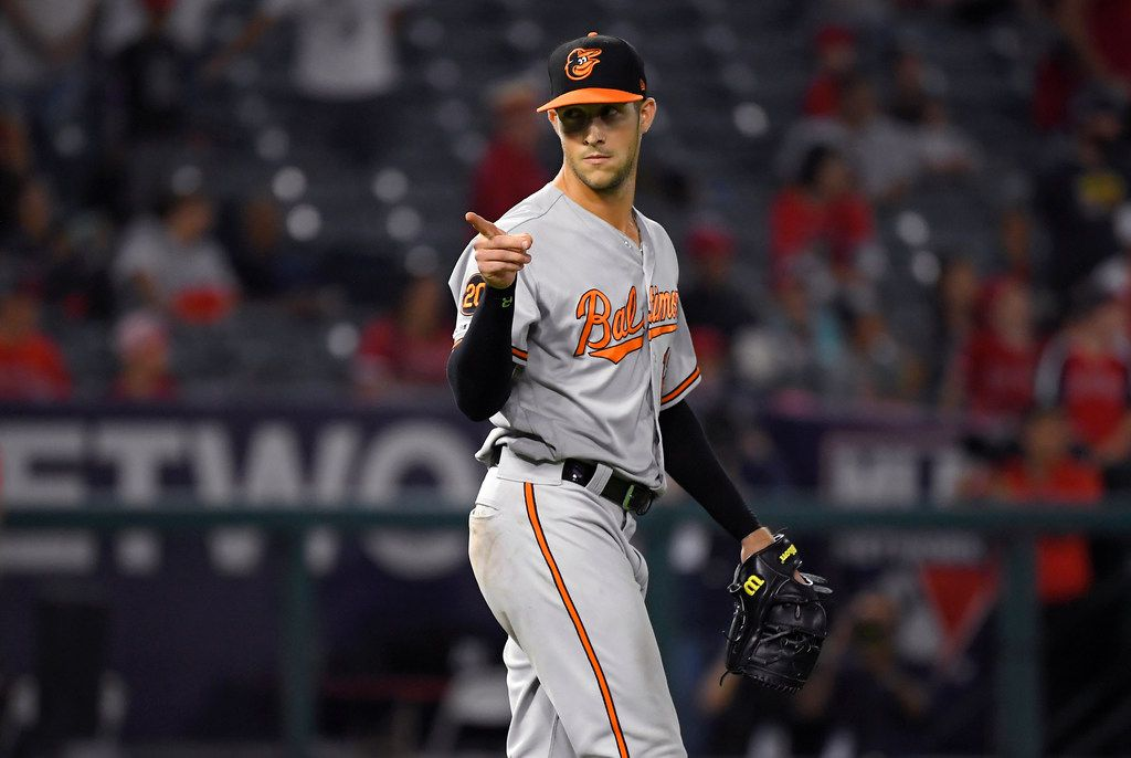 Baltimore Orioles outfielder Stevie Wilkerson gestures after the Orioles defeated the Los Angeles Angels 10-8 and pitching the 16th inning of a baseball game Friday, July 26, 2019, in Anaheim, Calif. (AP Photo/Mark J. Terrill)