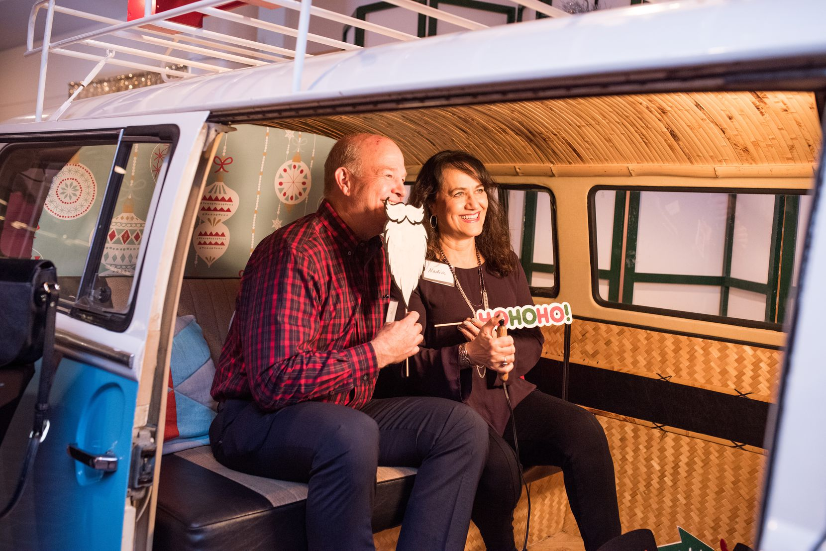 Hill & Wilkinson CEO Paul Driscoll and his wife Nadia enjoyed the retro VW bus photo booth at a company Christmas party at the Granville Arts Center in Garland.