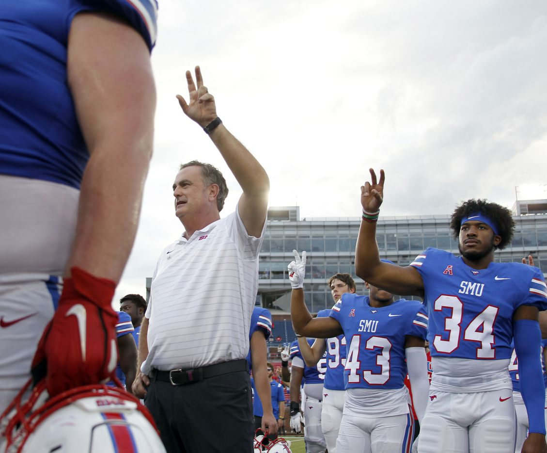 SMU head coach Sonny Dykes pauses with his players for the playing of the school song after SMU's 41-17 victory over South Florida. The two teams played their NCAA football game at SMU's Ford Stadium in Dallas on October 2, 2021. (Steve Hamm/ Special Contributor)
