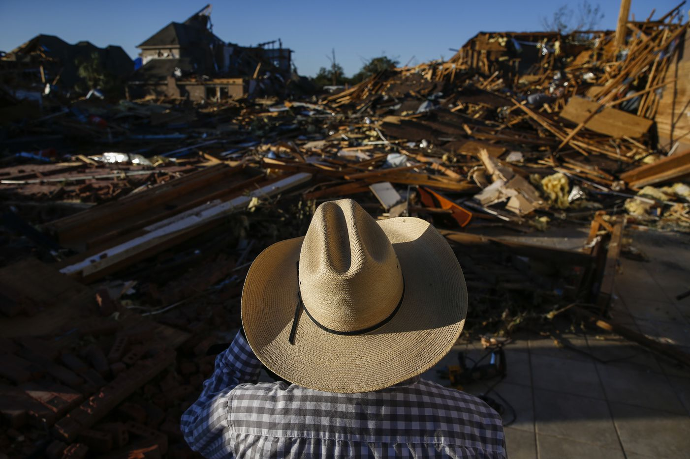 Hector Rodriguez, who has served as Deacon of Primera Iglesia Bautista Mexicana since 1987, surveys damage at the church just off of Walnut Hill Lane in Dallas, on Monday, Oct. 21, 2019 after a tornado hit the night before.