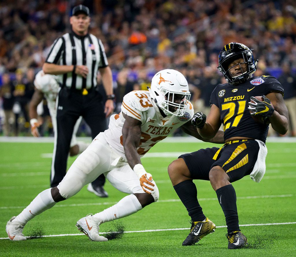 Missouri running back Ish Witter (21) is brought down by Texas linebacker Gary Johnson (33) during the second quarter of the Texas Bowl on Wednesday, Dec. 27, 2017, in Houston. (Smiley N. Pool/The Dallas Morning News)