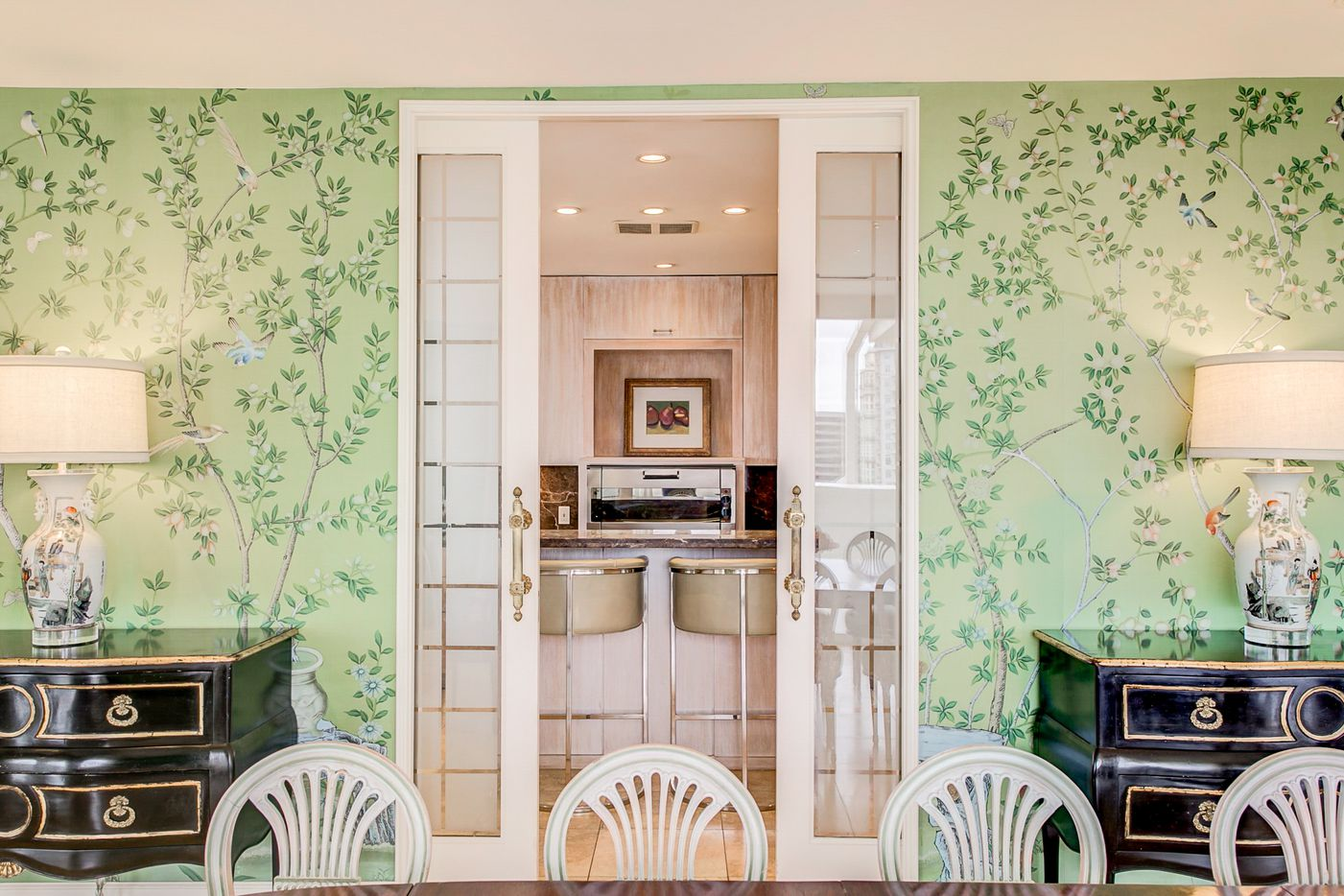 A look at the dining room access to the kitchen at 3701 Turtle Creek Boulevard Penthouse A in Dallas.