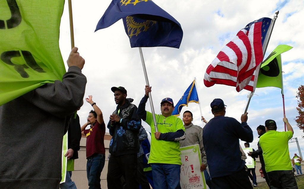A small number of Wal-Mart employees werejoined by a larger number of non-employees supporting them in a protest outside a Wal-Mart superstore along I-35E in Lancaster on Black Friday in 2012. (File Photo/Staff)