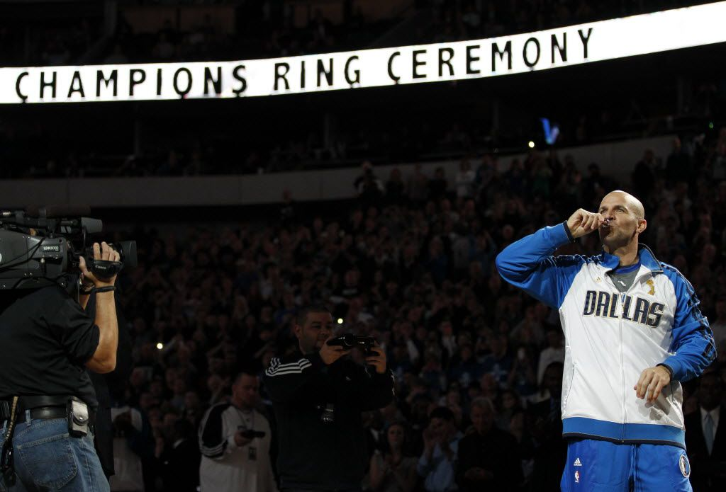 Dallas Mavericks point guard Jason Kidd (2) kisses his NBA championship ring during the ring ceremony at the American Airlines Center in Dallas on January 25, 2012. (Vernon Bryant/The Dallas Morning News)