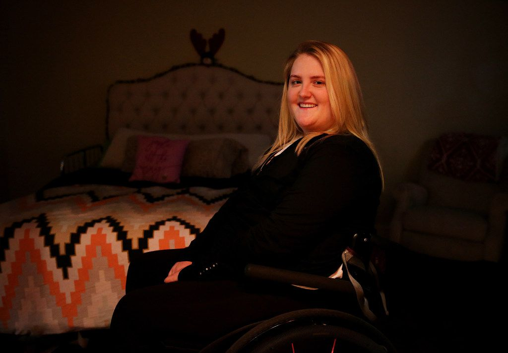 Sarah Milburn was paralyzed in an accident that occur following the driver of the Uber she was riding in running a red light. Milburn was photographed in her Dallas home Tuesday December 20, 2016. (Andy Jacobsohn/The Dallas Morning News)