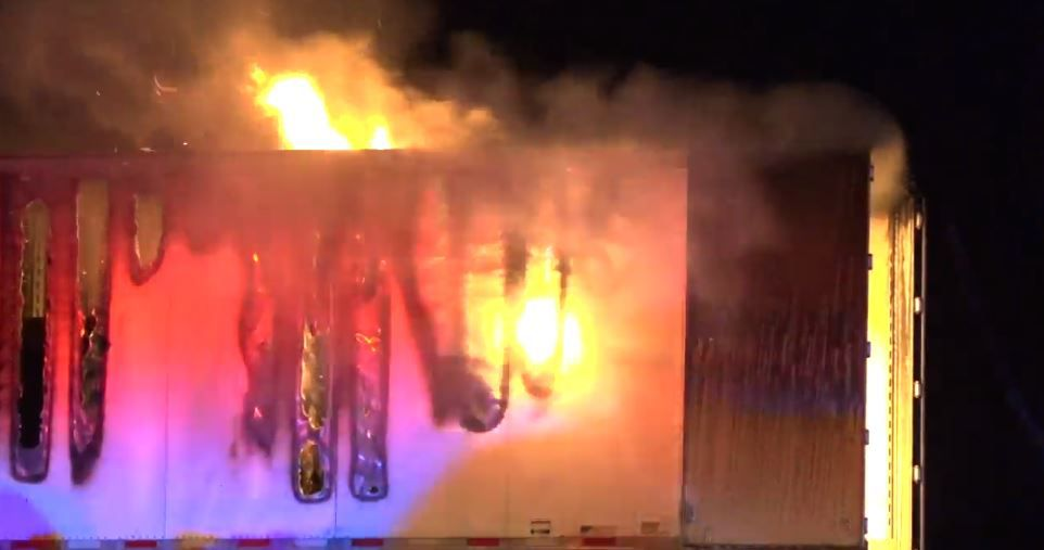 The cargo compartment of an 18-wheeler burns after catching fire on Interstate 20 in Terrell on Friday morning.