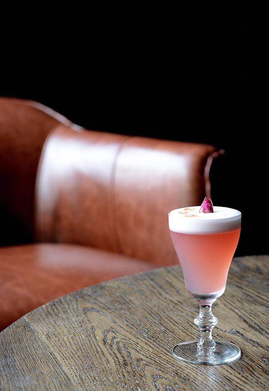 James Slater's Mystic Shrine is a coterie of pisco, blackberry liqueur, lemon, vanilla and egg white.