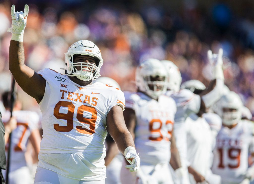 Texas Longhorns defensive lineman Keondre Coburn (99) celebrates after the Longhorns recovered a fumble during the second quarter of an NCAA football game between the University of Texas and TCU on Saturday, October 26, 2019 at Amon G Carter Stadium in Fort Worth. (Ashley Landis/The Dallas Morning News)