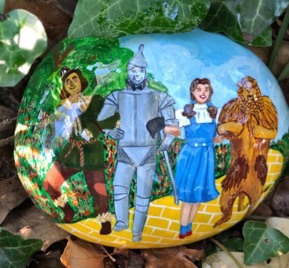Andrea Bracken painted this rock with an image of characters from The Wizard of Oz. Bracken, a Bedford, TX resident, sells rocks on Etsy. Some of her designs have been placed in the Parr Park Rock Art Trail.
