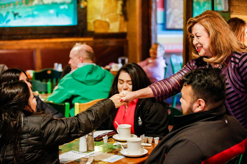 Dallas mayoral candidate Regina Montoya (right) introduces herself to Blanca Berlanda during a community breakfast.