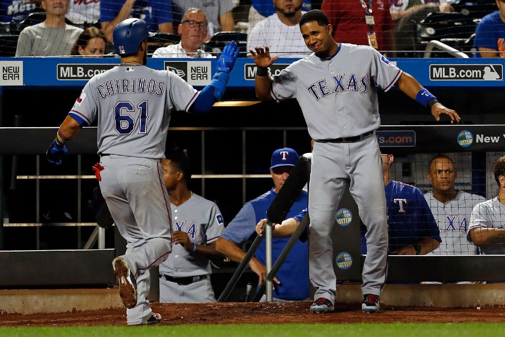 Texas Rangers Elvis Andrus congratulates Rangers Robinson Chirinos (61) on a solo home run during the ninth inning of an interleague baseball game against the New York Mets on Tuesday, Aug. 8, 2017, in New York. The Mets defeated the Rangers 5-4. (AP Photo/Adam Hunger)