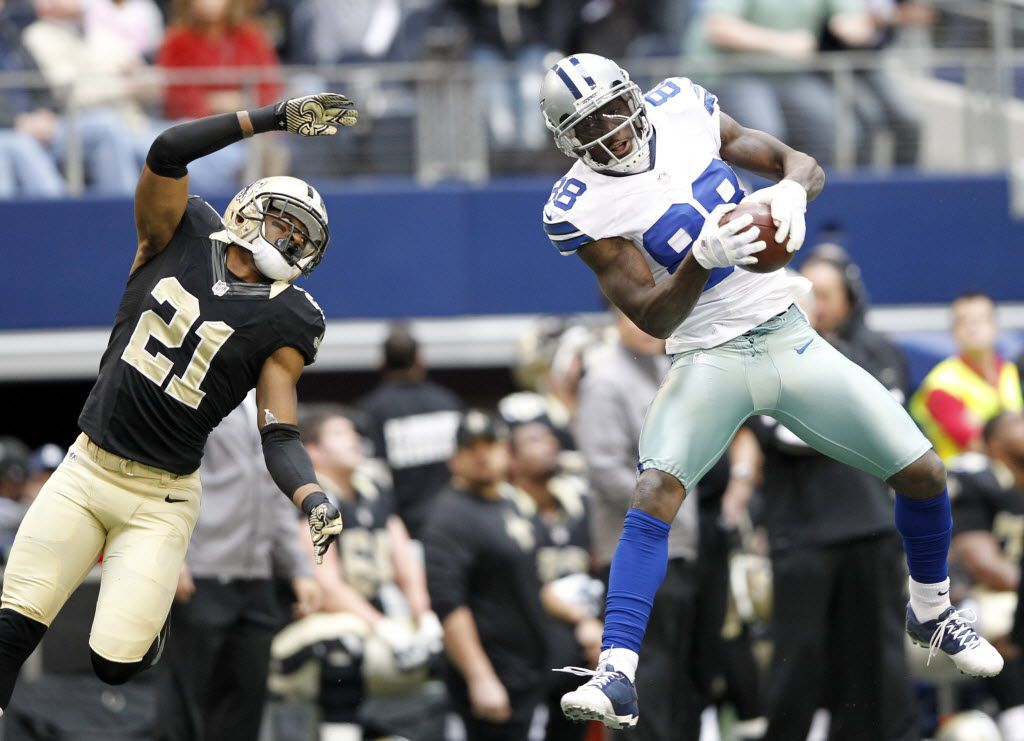 Dallas Cowboys wide receiver Dez Bryant (88) catches a pass in front of New Orleans Saints cornerback Patrick Robinson (21) during the first half of play at Cowboys Stadium in Arlington on December 23, 2012. Bryant went on to score a touchdown on this reception. (Vernon Bryant/The Dallas Morning News)