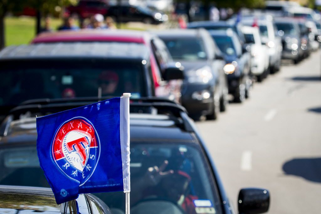 Traffic backs up waiting for the gates to Texas Rangers parking lots to open before an NFL football game between the Dallas Cowboys and the New England Patriots at AT&T Stadium in Arlington in 2015. The Rangers let Cowboys season-ticket holders use their parking lots if there are no conflicts with baseball games.