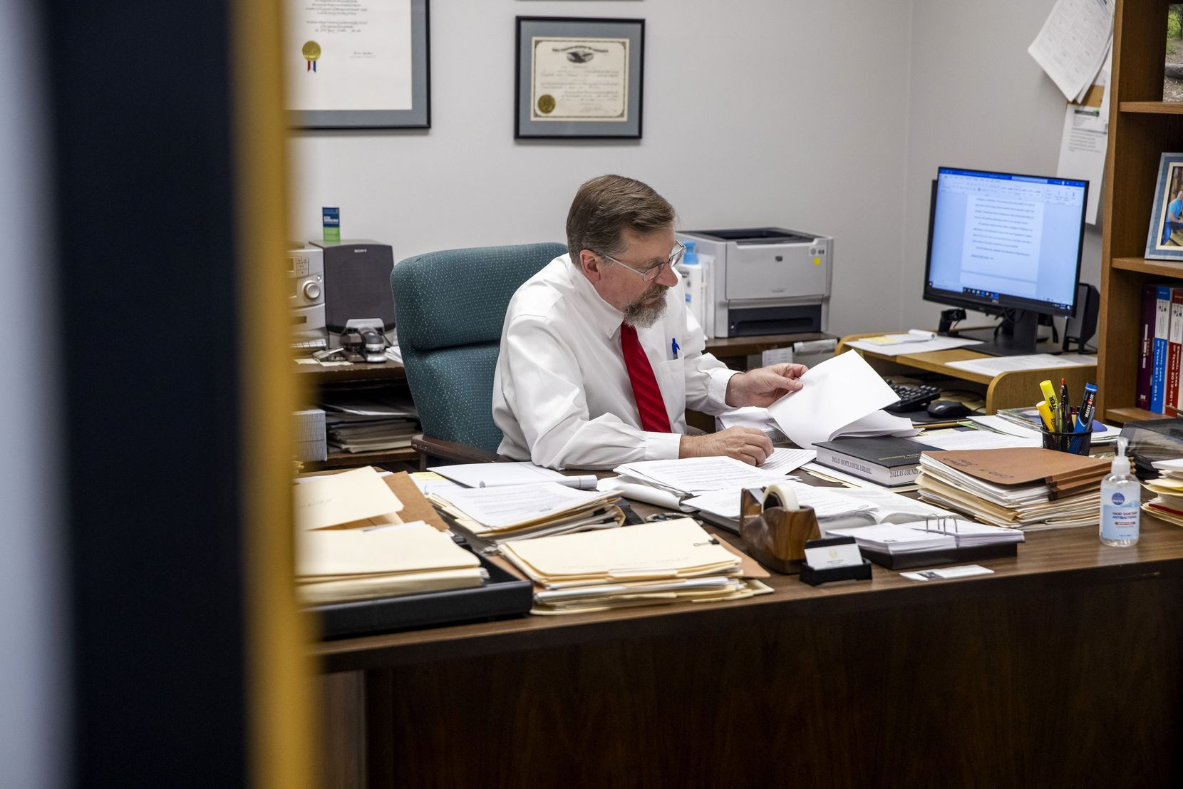 Dallas County Chief Staff Attorney Kerry Young worked at his office in the Frank Crowley Criminal Courts building in Dallas during his last week on the job.
